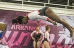 Hailey Garner of Arkansas dismounts from the beam against Missouri on Friday, Jan. 13, 2017 at Barnhill Arena in Fayetteville.