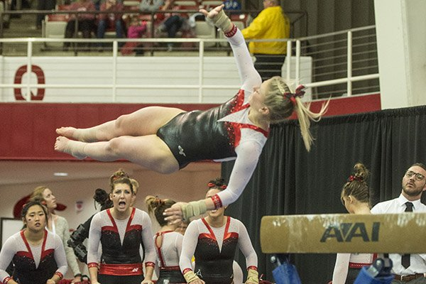 Samantha Nelson of Arkansas dismounts from the beam against Missouri Friday, Jan. 13, 2017 at Barnhill Arena in Fayetteville.