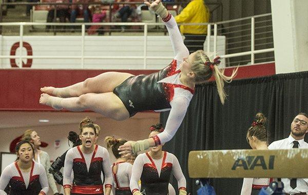 Samantha Nelson of Arkansas dismounts from the beam against Missouri Friday, Jan. 13, 2017 at Barnhill Arena in Fayetteville.