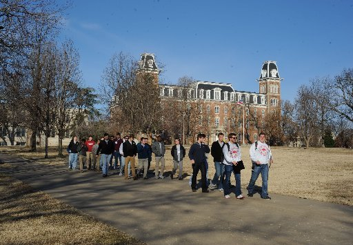 a-crowd-walks-saturday-feb-13-2016-past-old-main-and-the-university-of-arkansas-campus-in-fayetteville