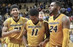 Missouri's Jordan Barnett (21) K.J. Walton (11) and Kevin Puryear (24) celebrate their 83-78 win over Arkansas in an NCAA college basketball game, Saturday Feb. 4, 2017, in Columbia, Mo. (Don Shrubshell/Columbia Daily Tribune via AP)