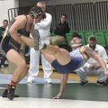 Bentonville High's Luke Brandon (left) takes Springdale Har-Ber's Logan Collins off his feet Saturda...