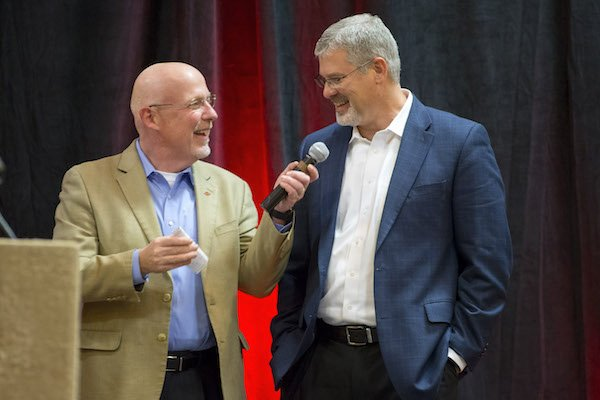 Chuck Barrett (left) talks with Arkansas defensive coordinator Paul Rhoads on Thursday, Feb. 2, 2017, on the team's signing day results during the Northwest Arkansas Razorback Club Signing on the Hill event at the Holiday Inn & Convention Center in Springdale.