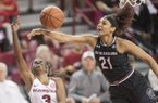 Arkansas' Malica Monk gets her shot blocked by South Carolina's Mikah Harrigan during a game Sunday Feb. 5, 2017, at Bud Walton Arena in Fayetteville. South Carolina won 79-49.