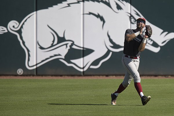 Arkansas outfielder Luke Bonfield makes a catch during a scrimmage Monday, Oct. 17, 2016, in Fayetteville.