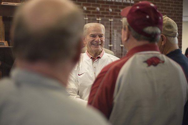 Former Arkansas baseball coach Norm DeBriyn, (center) visits with friends Monday, Feb. 6, 2017, during a reception to honor DeBriyn's retirement from the Razorback Foundation. DeBriyn coached the Diamond Hogs from 1970 to 2002, and has worked at the Razorback Foundation since. More than 100 people came to congratulate DeBriyn and wish him well on his retirement.
