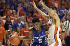 Kentucky guard Malik Monk (5) dribbles past Florida guard Chris Chiozza (11) during the second half of an NCAA college basketball game in Gainesville, Fla., Saturday, Feb. 4, 2017. Florida won 88-66. (AP Photo/Ron Irby)