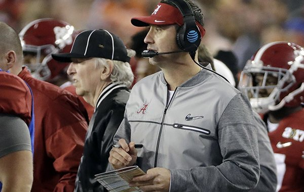 Alabama offensive coordinator Steve Sarkisian is seen on the sidelines during the second half of the NCAA college football playoff championship game against Clemson Monday, Jan. 9, 2017, in Tampa, Fla. (AP Photo/David J. Phillip)