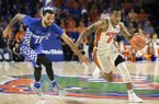 Florida guard Kasey Hill (0) dribbles past Kentucky guard Mychal Mulder (11) on a fast break during the second half of an NCAA college basketball game in Gainesville, Fla., Saturday, Feb. 4, 2017. Florida won 88-66. (AP Photo/Ron Irby)