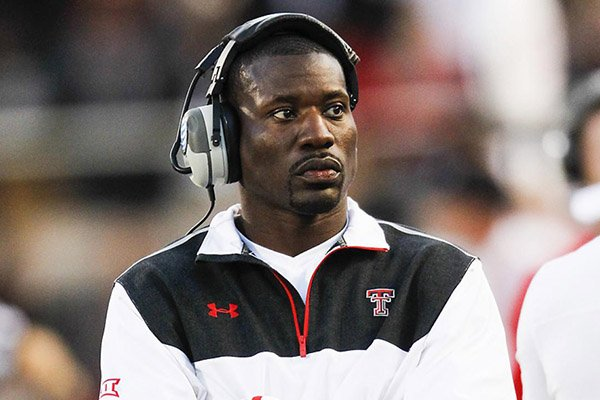 Texas Tech defensive line coach John Scott, Jr. paces the sideline during the first half of a 34-13 loss to Texas on Saturday, Nov. 1, 2014, at Jones AT&T Stadium in Lubbock, Texas. (Icon Sportswire via AP Images)