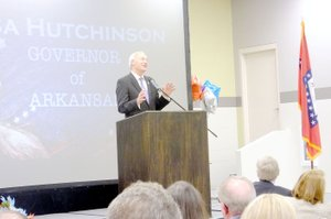 Lynn Atkins/Governor Asa Hutchinson introduced his long time colleague Mike Hutchinson to the Republicans gathered for dinner at Pea Ridge High School last week.