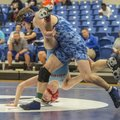 Jake Turner, Rogers sophomore, flips Bailey Fry of Fort Smith Southside, during a match Tuesday, Jan...