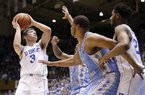 Duke's Grayson Allen (3) looks to shoot while North Carolina's Nate Britt, rear, and Kennedy Meeks (3) defend as Duke's Marques Bolden watches at right during the first half of an NCAA college basketball game in Durham, N.C., Thursday, Feb. 9, 2017. (AP Photo/Gerry Broome)