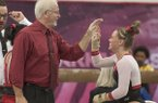 Arkansas head coach Mark Cook congratulates Mia Bargiacchi on her floor routine against Missouri Friday, Jan. 13, 2017 at Barnhill Arena in Fayetteville.