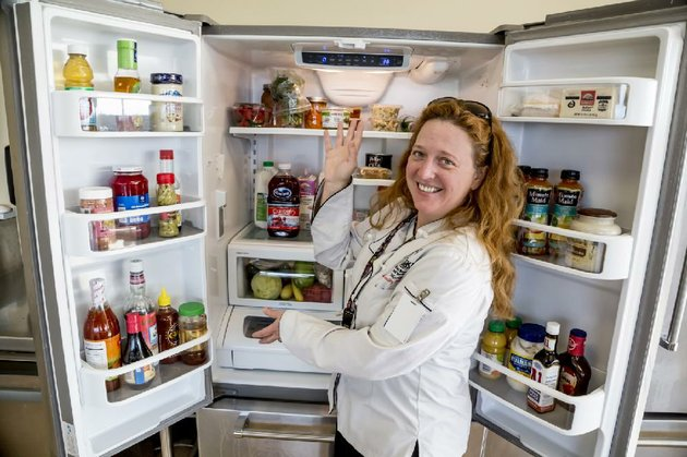 chef-jolie-mosley-lead-culinary-instructor-at-pulaski-technical-colleges-culinary-arts-and-hospitality-management-institute-in-little-rock-shows-how-to-organize-a-refrigerator-for-safety-and-convenience-the-basic-idea-organize-according-to-the-coldest-shelves-and-raw-meat-goes-on-the-bottom
