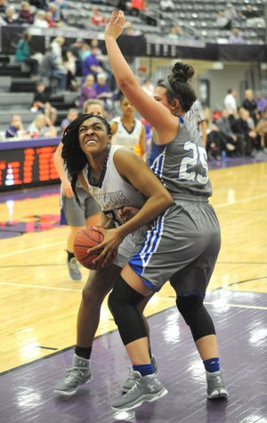 Fayetteville forward Jasmine Franklin (left) attempts to shoot around Rogers forward Madison Sandor on Friday at Bulldog Arena. Visit nwadg.com/photos for more photos from the game.