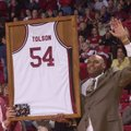 University of Arkansas athletics director Frank Broyles presents Dean Tolson with a framed jersey du...