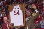 University of Arkansas athletics director Frank Broyles presents Dean Tolson with a framed jersey during halftime of the Arkansas-Mississippi State game Saturday, March 1, 2003, at Bud Walton Arena in Fayetteville.