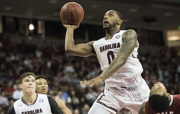South Carolina guard Sindarius Thornwell (0) shoots over Alabama forward Shannon Hale, right, during the second half of an NCAA college basketball game Tuesday, Feb. 7, 2017, in Columbia, S.C. Alabama defeated South Carolina 90-86. (AP Photo/Sean Rayford)