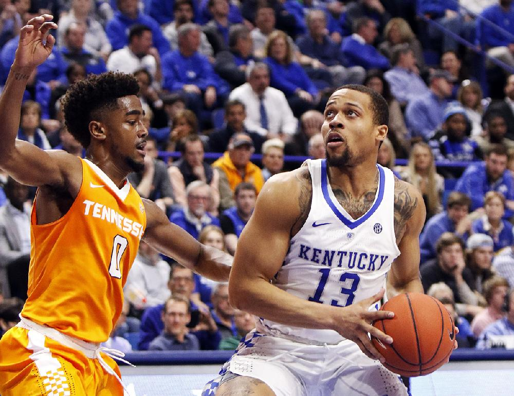 Kentucky guard Isaiah Briscoe (right) eyes the basket ...
