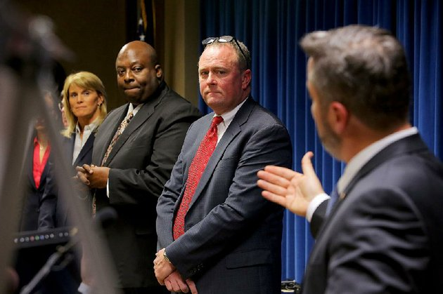 little-rock-fbi-special-agent-in-charge-diane-upchurch-from-left-little-rock-police-chief-kenton-buckner-and-us-attorney-for-the-eastern-district-of-arkansas-christopher-thyer-listen-as-jeffrey-reed-resident-agent-in-charge-of-the-atf-speaks-tuesday-in-little-rock-about-the-progress-made-during-the-violence-reduction-network-initiative