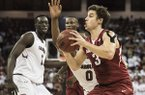Arkansas guard Dusty Hannahs (3) drives to the hoop against South Carolina guard Sindarius Thornwell (0) during the first half of an NCAA college basketball game Wednesday, Feb. 15, 2017, in Columbia, S.C. Arkansas defeated South Carolina 83-76. (AP Photo/Sean Rayford)