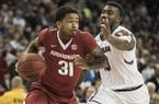 Arkansas guard Anton Beard (31) drives to the hoop against South Carolina guard Duane Notice (10) during the second half of an NCAA college basketball game, Wednesday, Feb. 15, 2017, in Columbia, S.C. Arkansas defeated South Carolina 83-76. (AP Photo/Sean Rayford)
