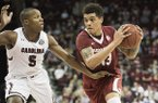 Arkansas forward Dustin Thomas (13) drives to the hoop against South Carolina guard TeMarcus Blanton (5) during the first half of an NCAA college basketball game Wednesday, Feb. 15, 2017, in Columbia, S.C. Arkansas defeated South Carolina 83-76. (AP Photo/Sean Rayford)
