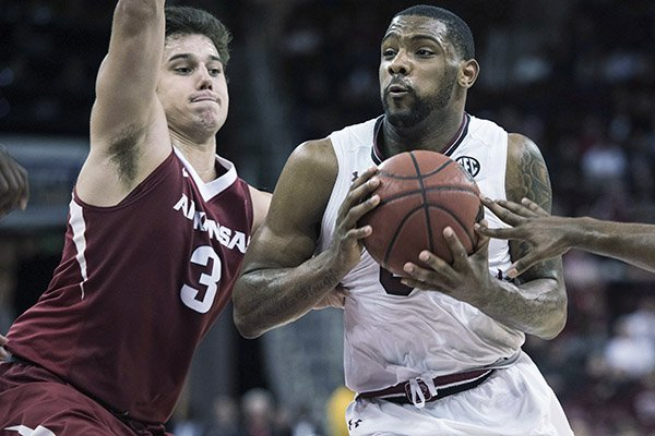 South Carolina guard Sindarius Thornwell, right, drives to the hoop against Arkansas guard Dusty Hannahs (3) during the second half of an NCAA college basketball game Wednesday, Feb. 15, 2017, in Columbia, S.C. Arkansas defeated South Carolina 83-76. (AP Photo/Sean Rayford)