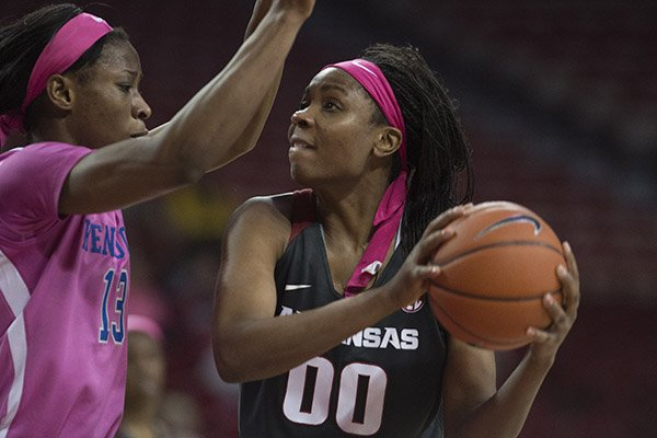 Arkansas' Jessica Jackson eyes the basket while Kentucky's Evelyn Akhator defends during the second half of a game Thursday Feb. 16, 2017, at Bud Walton Arena in Fayetteville. The Wildcats won 69-62.