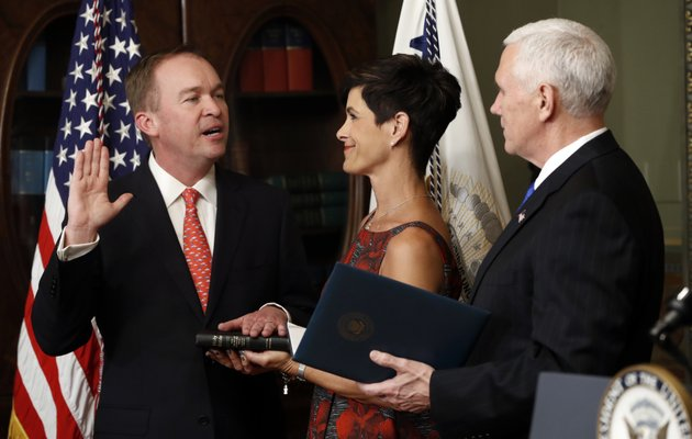 vice-president-mike-pence-swears-in-mick-mulvaney-as-director-of-office-of-management-and-budget-in-the-white-house-complex-in-washington-thursday-feb-16-2017-as-pamela-west-mulvaney-holds-the-bible