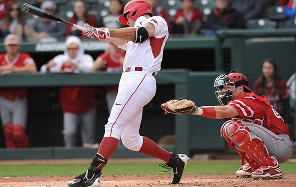Arkansas left fielder Luke Bonfield connects against Miami (Ohio) Friday, Feb. 17, 2017, during the first inning at Baum Stadium in Fayetteville.