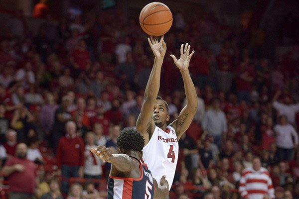 Daryl Macon (4) of Arkansas shoots for three as Marcanvis Hymon (5) of Ole Miss defends in the second half Saturday, Feb. 18, 2017, during the game at Bud Walton Arena in Fayetteville.