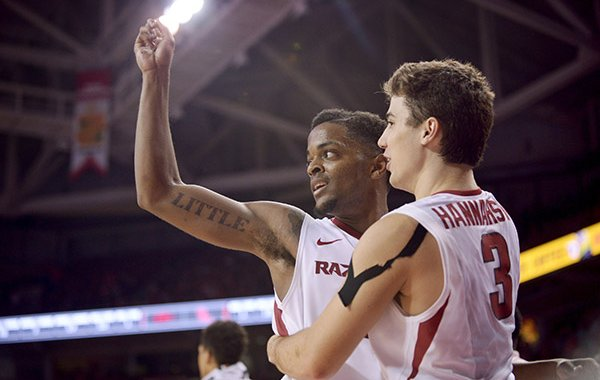 Daryl Macon and Dusty Hannahs of Arkansas celebrate as the Razorbacks close in on a victory over Ole Miss Saturday, Feb. 18, 2017, during the game at Bud Walton Arena in Fayetteville.