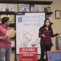 Fernando Garcia (left) and Diana Dominguez speak Feb. 10 to a group at Arkansas United Community Coa...