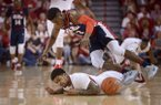 Anton Beard of Arkansas and Terence Davis of Ole Miss dive for a loose ball in the first half Saturday, Feb. 18, 2017, during the game at Bud Walton Arena in Fayetteville.