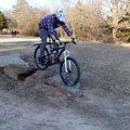 A skills loop is now part of the soft trail at Lake Fayetteville. Pack bumps over boulders during a ...