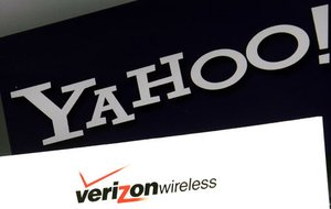 This Monday, July 25, 2016, file photo shows the Yahoo and Verizon logos on a laptop, in North Andover, Mass.