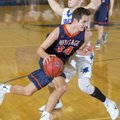 Rogers Heritage junior Seth Stanley drives around Rogers High senior Jake Benninghoff on Tuesday, Fe...