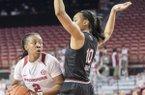 Arkansas' Aaliyah Wilson looks for help while South Carolina's Allisha Gray defends Sunday Feb. 5, 2017 at Bud Walton Arena in Fayetteville. South Carolina won 79-49.