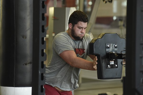 Arkansas offensive lineman Shane Clenin goes through a workout Tuesday, Jan. 31, 2017, at Fred W. Smith Center in Fayetteville.