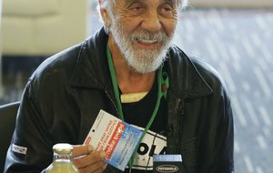 """In this Feb. 19, 2015 file photo, comedian and marijuana icon Tommy Chong, talks about his line of marijuana products, including his """"Chongwater"""" hemp drink, a custom joint roller, and his """"Smoke Swipe"""" wipes that can remove the odor of pot smoke from clothing, during CannaCon, a marijuana business trade show in Seattle. Chong tweeted Thursday, Feb. 23, 2017, """"Don't worry stay High"""" in response to a potential crackdown on recreational pot use by the Trump administration."""