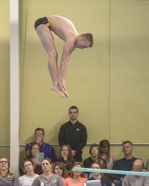 NWA Democrat-Gazette/ANTHONY REYES @NWATONYR Kyle Nichols of Bentonville High performs his final dive Friday during the Arkansas High School Swim and Dive Championships at the Bentonville Community Center in Bentonville.