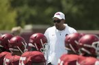 Arkansas linebackers coach Vernon Hargreaves talks to players during warmups on Saturday, Aug. 8, 2015, in Fayetteville.
