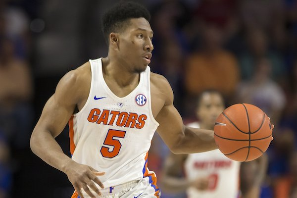 Florida guard KeVaughn Allen (5) dribbles up the court during the second half of an NCAA college basketball game against Arkansas in Gainesville, Fla., Wednesday, March 1, 2017. Florida won 78-65. (AP Photo/Ron Irby)