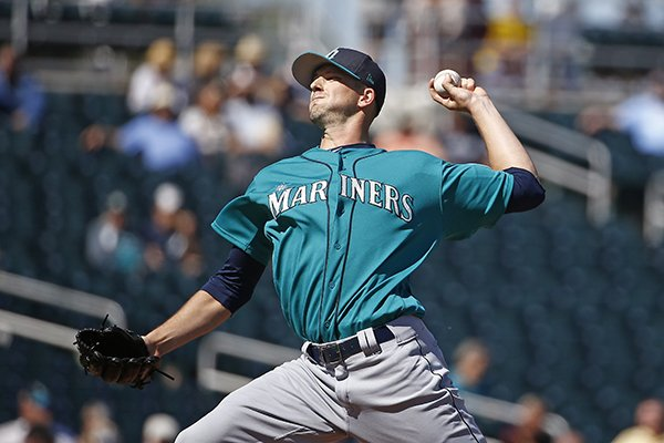 Seattle Mariners starting pitcher Drew Smyly throws a pitch during the first inning of a spring training baseball game against the Cleveland Indians Wednesday, March 1, 2017, in Goodyear, Ariz. (AP Photo/Ross D. Franklin)