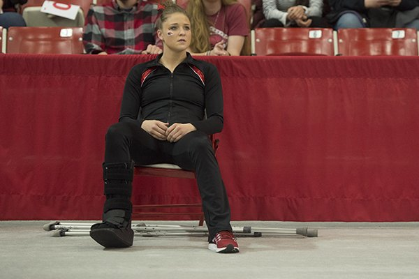 Amanda Wellick of Arkansas watches her teammates against Missouri Friday, Jan. 13, 2017 at Barnhill Arena in Fayetteville. Wellick was injured during warmups and was pulled from competition.