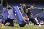 Arkansas defensive end Deatrich Wise runs a drill at the NFL football scouting combine in Indianapolis, Sunday, March 5, 2017.
