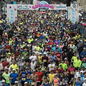 Runners burst from the starting line on Scott Street to begin the 2017 Little Rock Marathon. Nearly 2,500 braved a cold rain and mist to participate in the 15th running of the race, which covered 26.2 miles and began in downtown Little Rock.