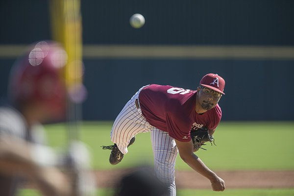 Arkansas pitcher Isaiah Campbell throws during a scrimmage Monday, Oct. 17, 2016, at Baum Stadium in Fayetteville.